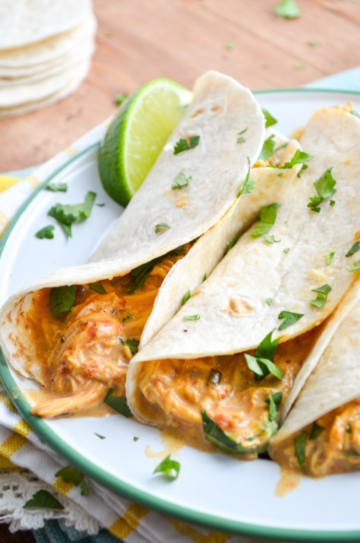 Queso Chicken Tacos, garnished with lime and cilantro.