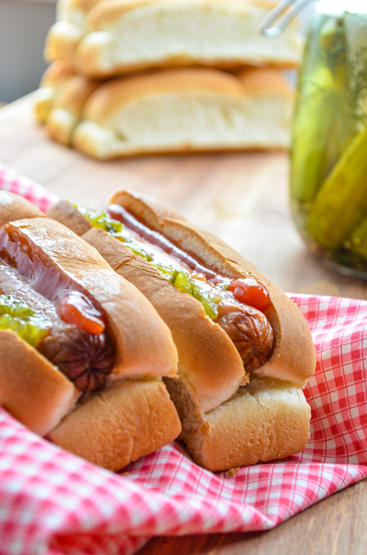 Hot dogs, prepared with toasted buns and classic toppings.