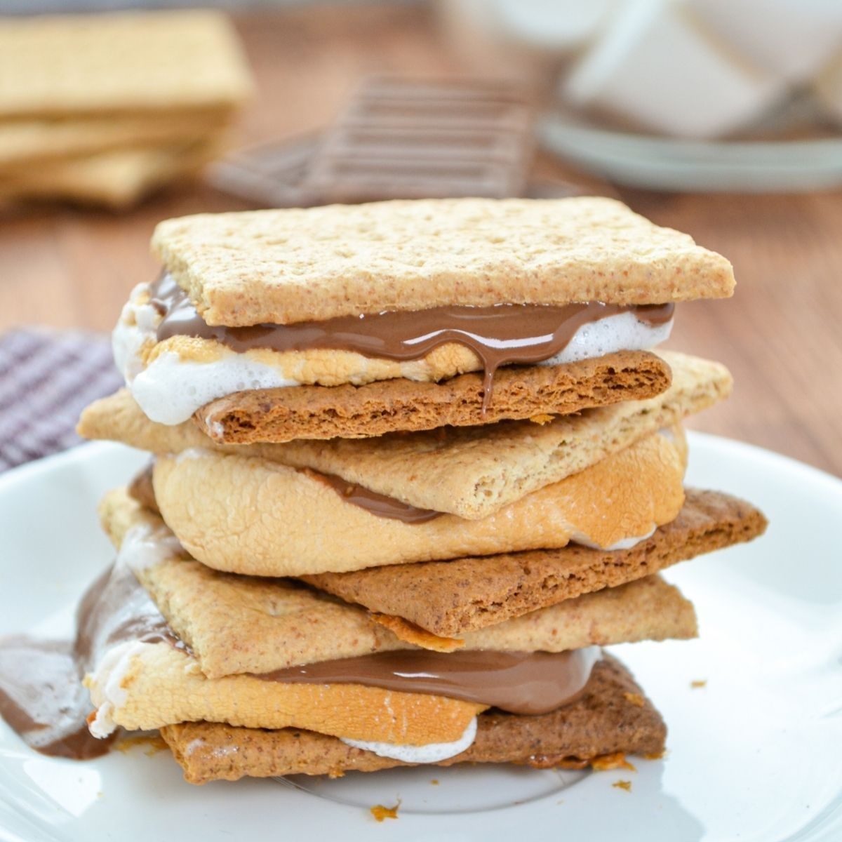 A stack of S'mores on a plate.