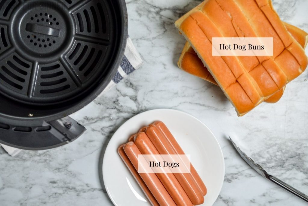 The ingredients needed to make air fryer hot dogs: hot dogs and hot dog buns.