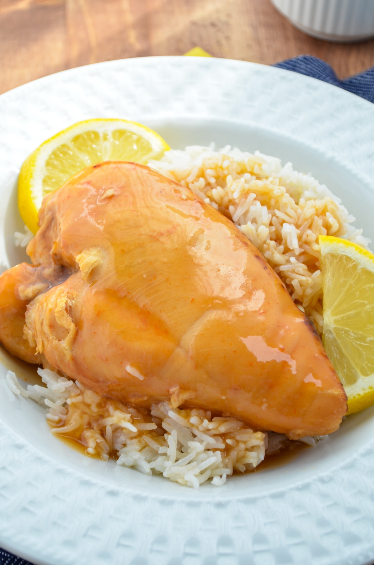 Slow cooker lemonade chicken, served on a bed of rice.