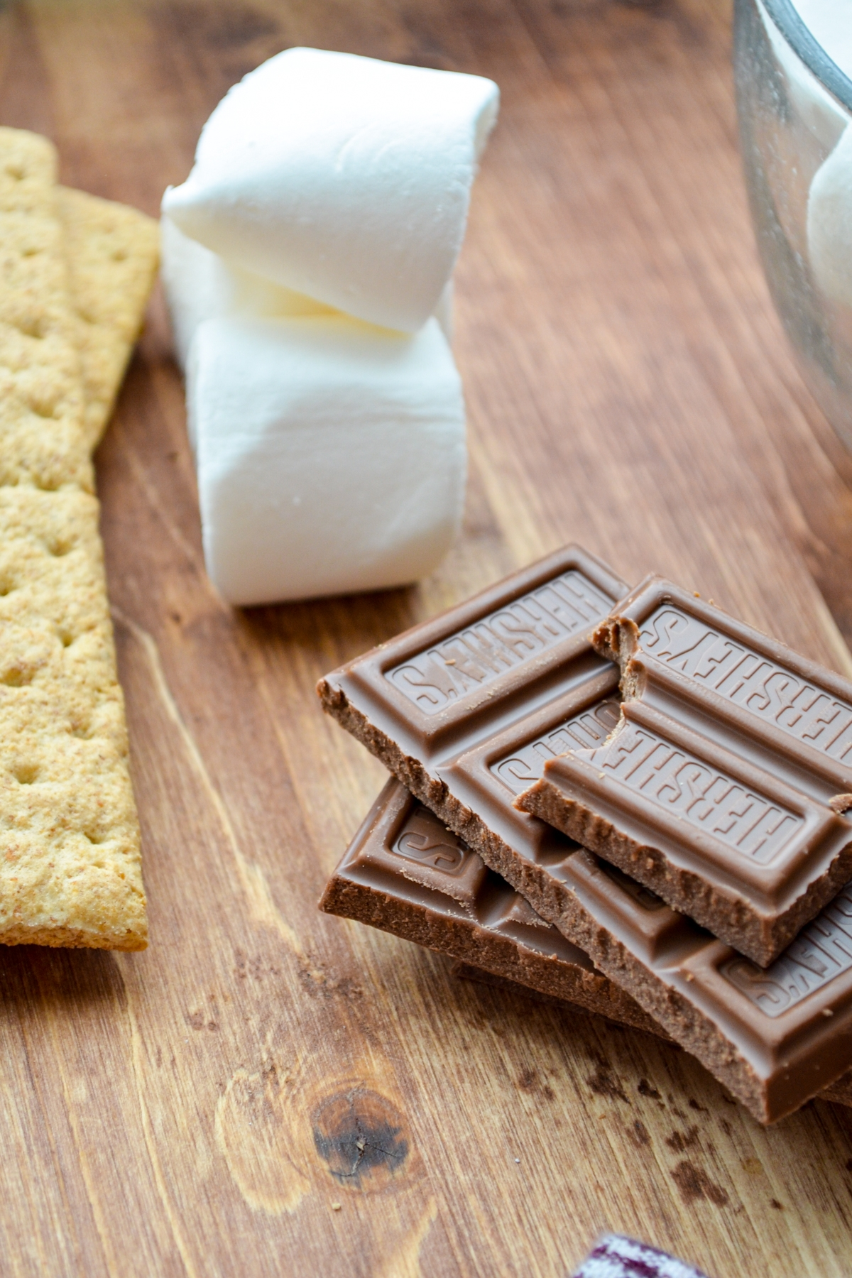 A few bars of chocolate, some marshmallows, and some graham crackers.
