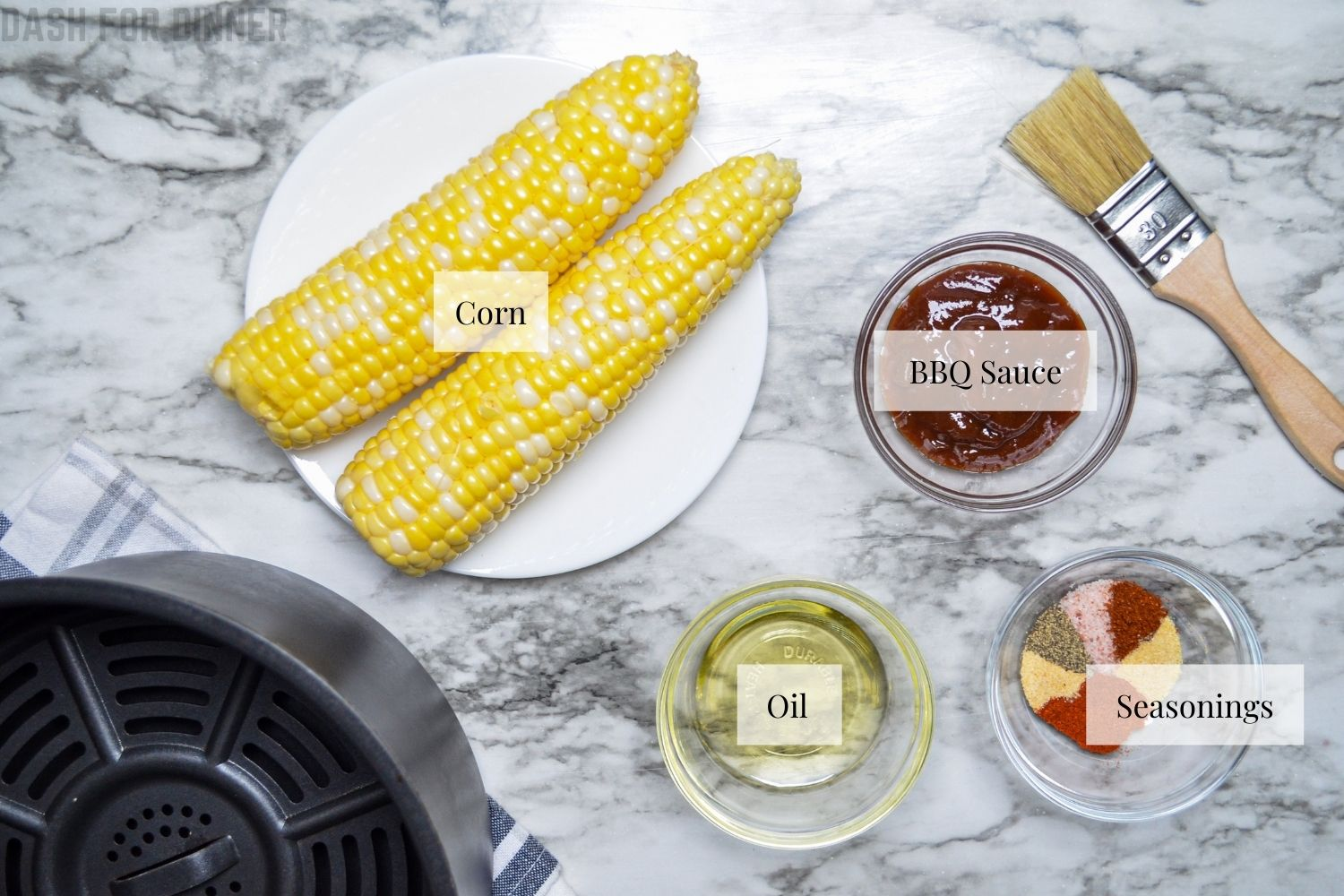 The ingredients needed to make air fryer corn ribs.