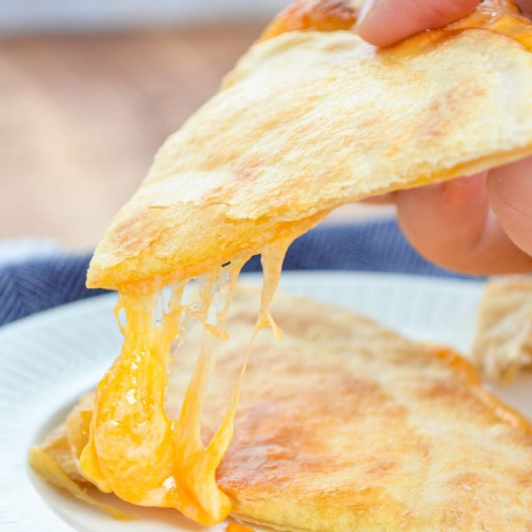 An air fryer quesadilla, with a big stretch of cheese.