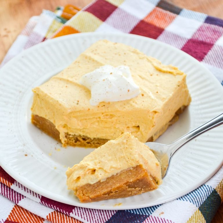 A fork with a portion of no bake pumpkin cheesecake bars.