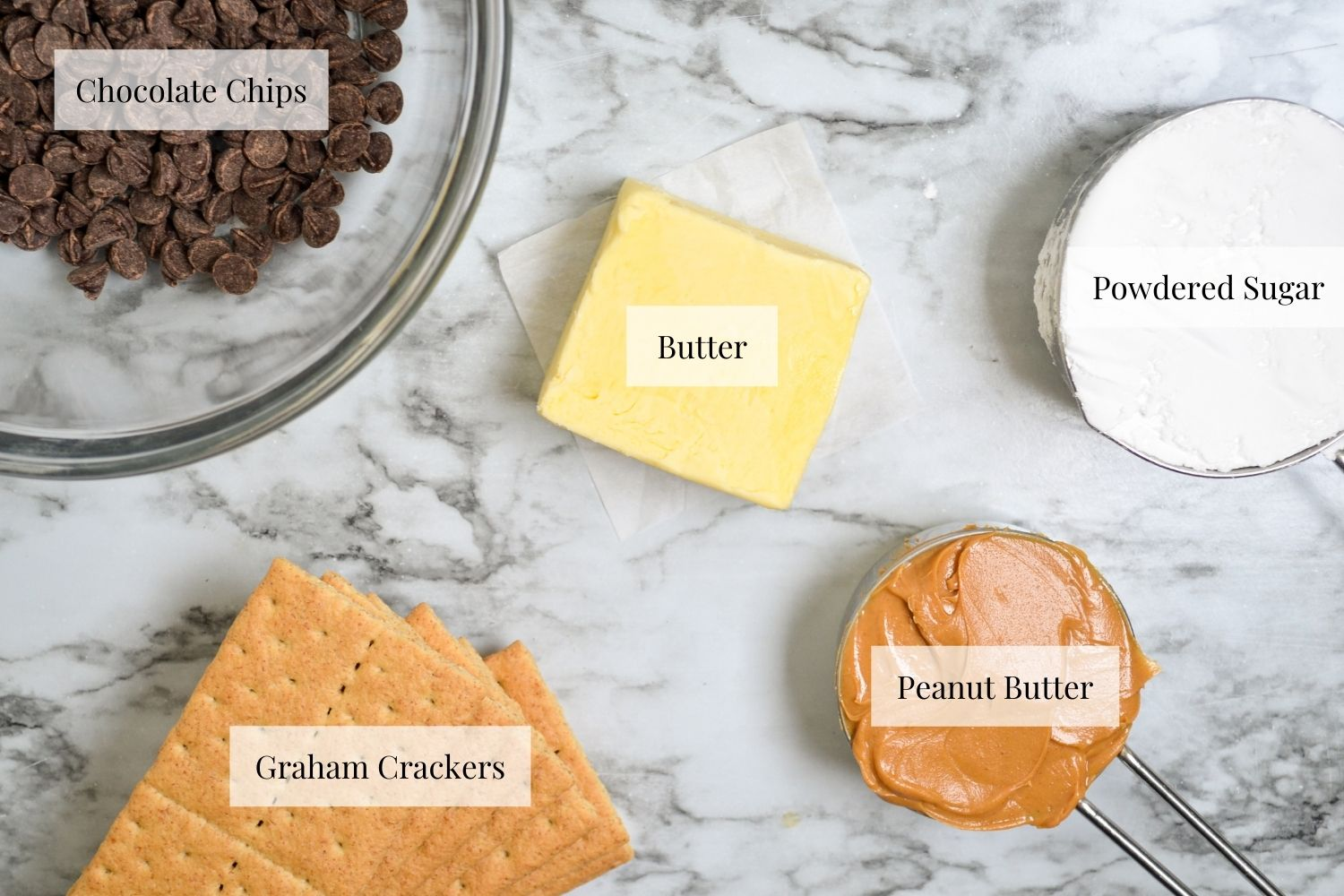 Ingredients needed to make no bake peanut butter bars: graham crackers, peanut butter, butter, powdered sugar, and chocolate chips.