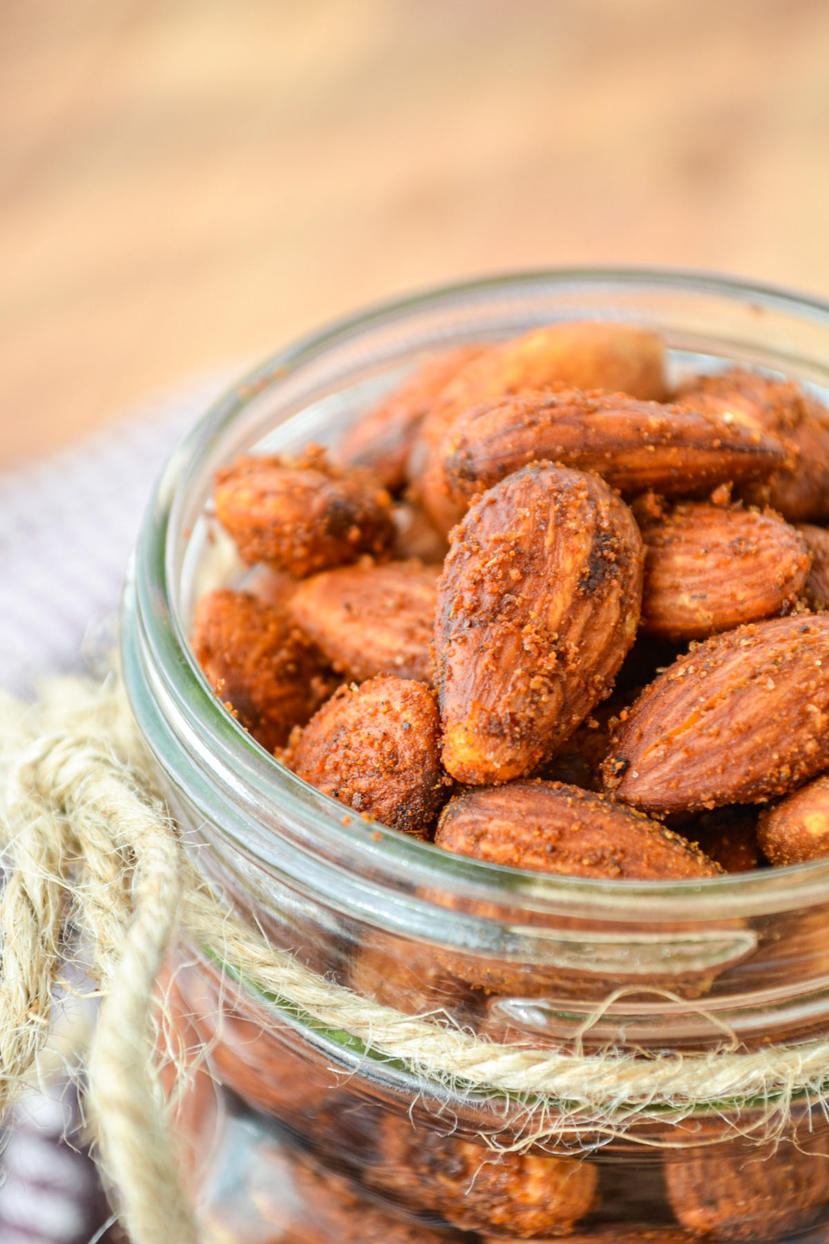 A pint jar filled with roasted almonds.