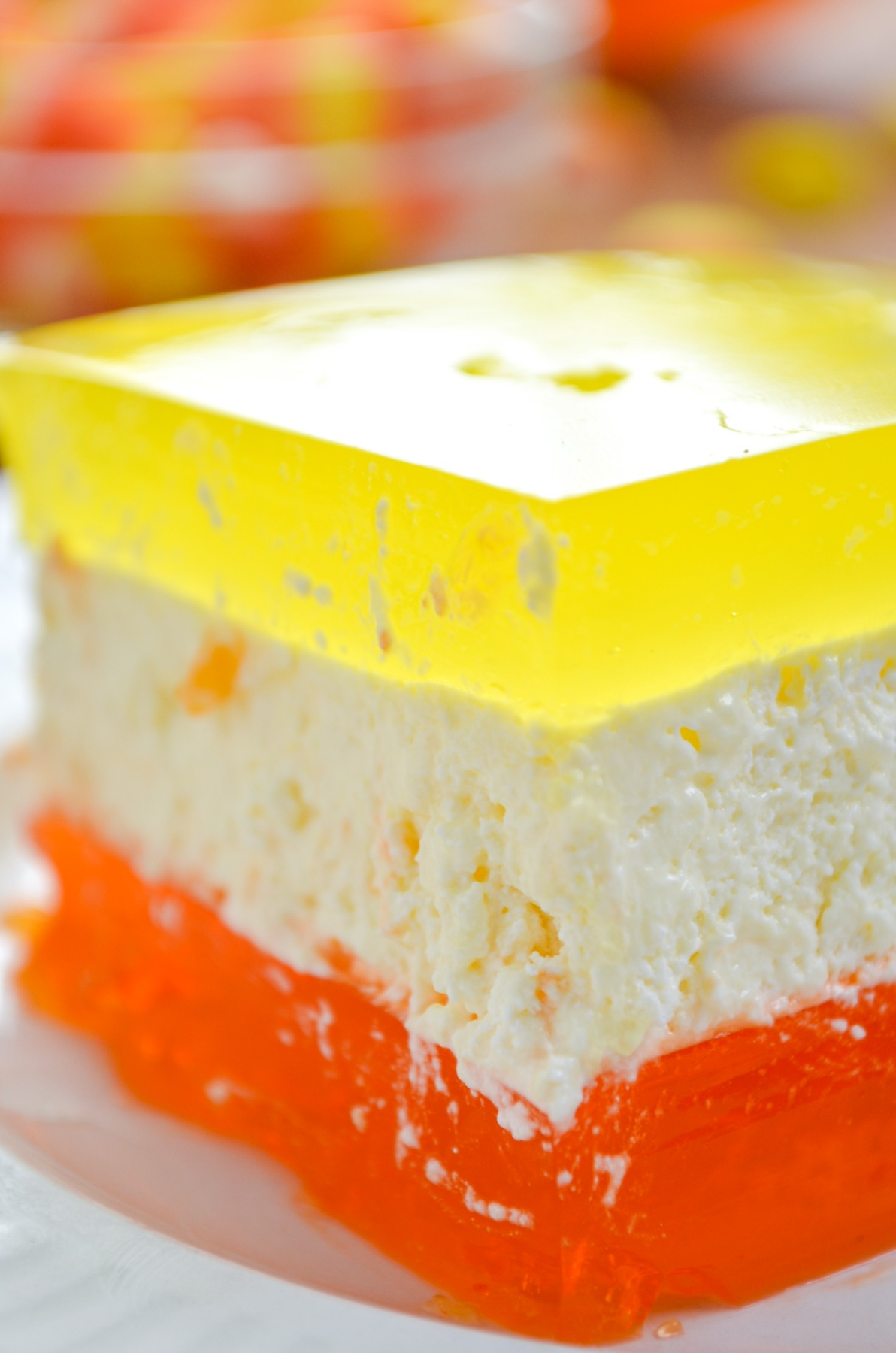 Halloween layered Jell-O with an orange layer, cheesecake layer, and a lemon layer.