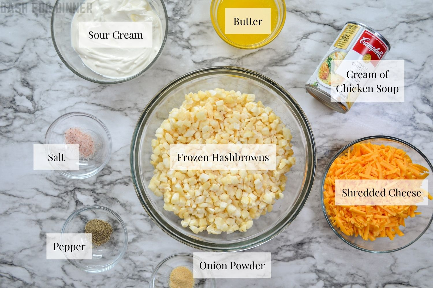 The ingredients needed to make slow cooker cheesy hashbrown casserole.