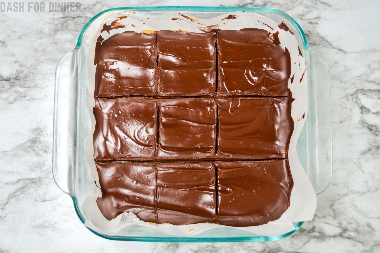 No bake peanut butter bars cut into 9 squares.