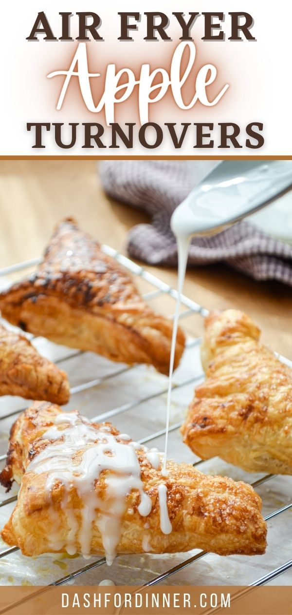 Apple turnovers being drizzled with a homemade glaze.