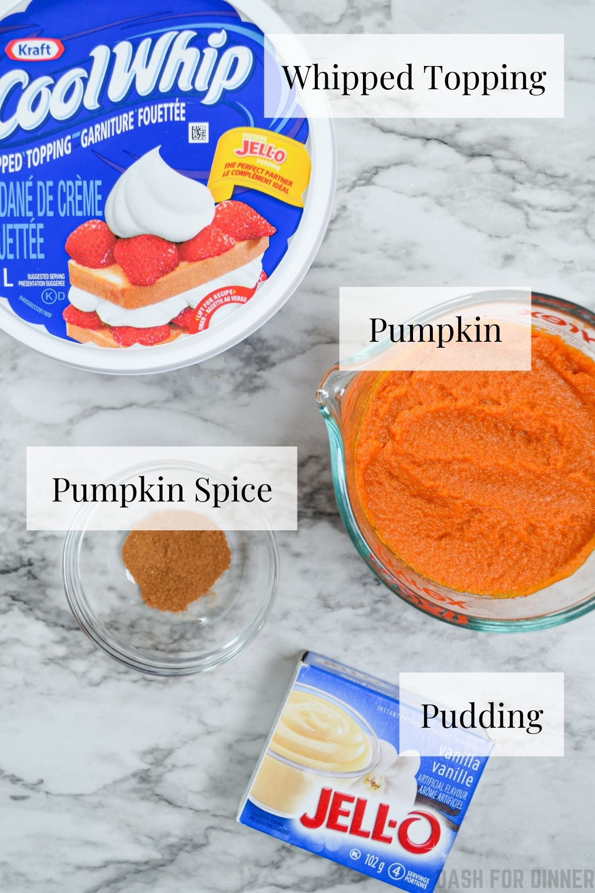 The four ingredients you need to make pumpkin fluff: cool whip, pumpkin, vanilla pudding mix, and pumpkin spice.